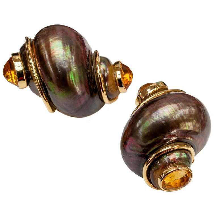 Seaman Schepps bronze colored shell and citrine gold ear clips circa 1990.  The classic Seaman Schepps shell design featuring unique characteristics.  We like that the color of the shells is uncommon, a very attractive bronze made even more