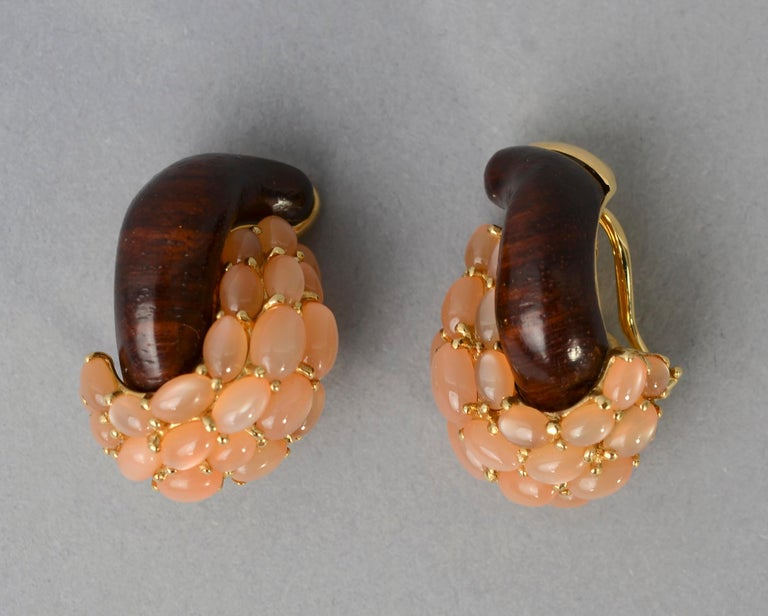Elegant and unusual pink moonstone and wood (probably ebony) half link earrings by Seaman Schepps. The pink moonstones are a wonderfully warm color that plays off beautifully with the wood. Clip backs can be converted to posts. 18 karat gold with
