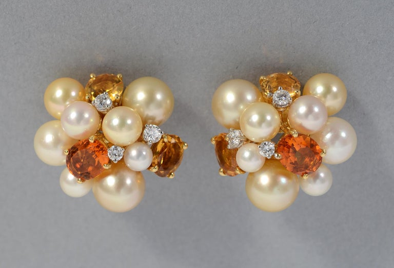 Large and elegant cluster Bubble earrings by Seaman Schepps. The earrings combine 7 pearls of different sizes; three oval citrines in two colors and three round diamonds. The stones are mounted at different heights and angles giving a less formal