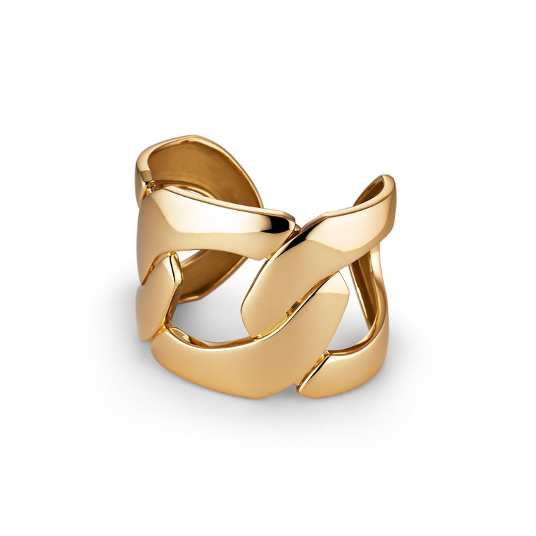 You will be forever linked-in when wearing this chunky Seaman Schepps yellow gold cuff.  With three intertwined and oversized links, this statement cuff is a chic and architecturally strong modern accessory.  18 karat gold.   Seaman Schepps