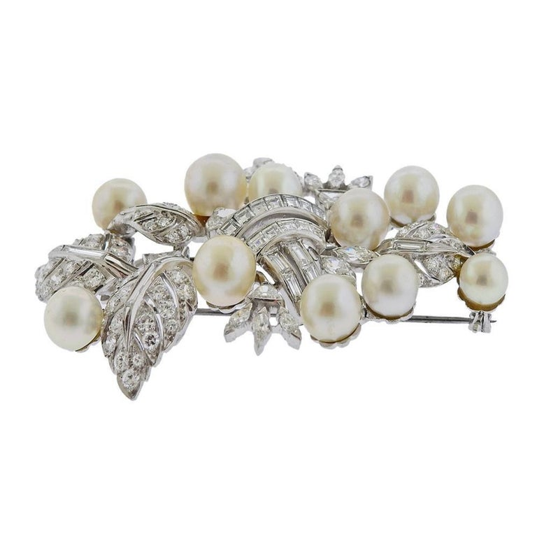 Impressive large platinum brooch by Seaman Schepps, set with 6mm - 8.5mm pearls and approx. 5.00ctw in diamonds. Measures 65mm x 44mm. Marked: Seaman Schepps, Irid. Plat.  Weight - 31.1 grams. PB-03027