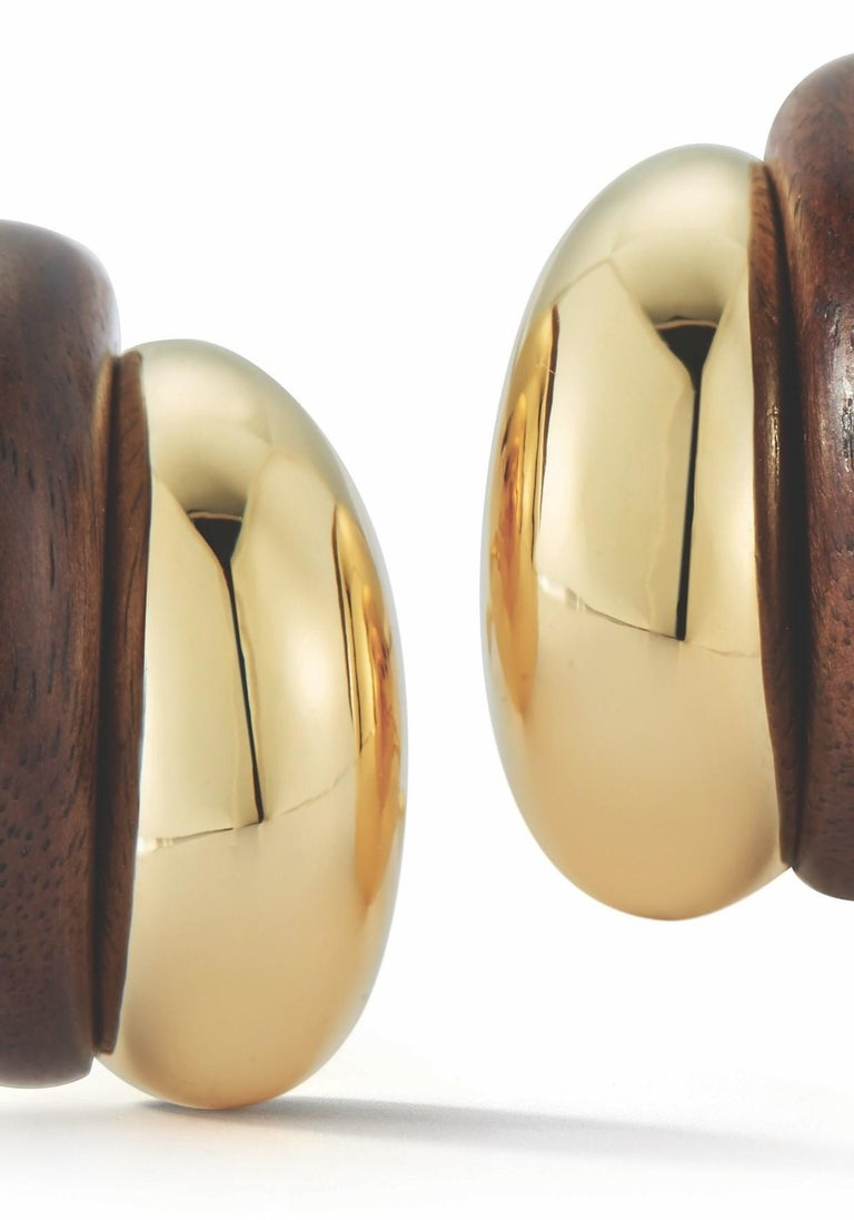 Brand new 18k gold earrings crafted for the Silhouette collection featuring walnut wood. Crafted by Seaman Schepps. Earrings measure 22mm X 17mm and weigh 18.7 grams. Marked Maker's Mark 750 245880. Brand new with packaging.