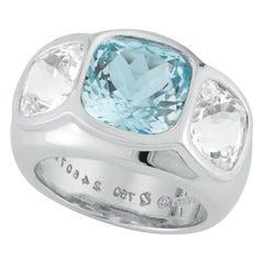 Seaman Schepps Three-Stone Blue and White Topaz Mogul 18 Karat White Gold Ring