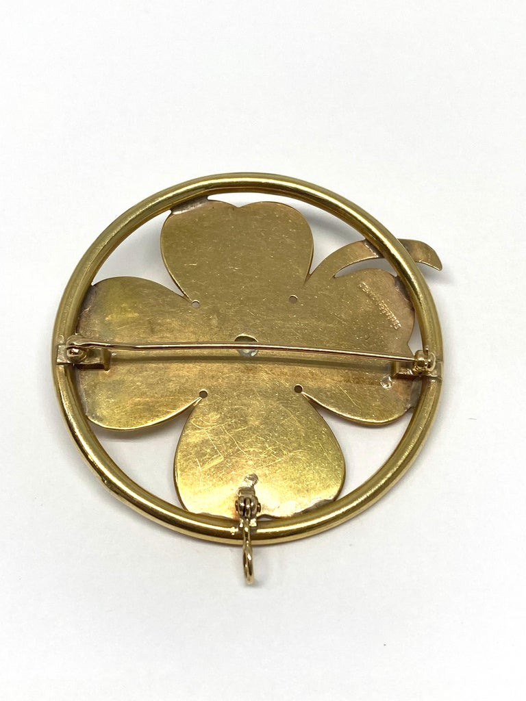 Product details; Circa 1950's. Featuring 14K yellow gold and mobe pear (14mm diameter) detail in the middle, clover motif.  From the RETRO period.  2 in 1 brooch and pendant.  Signed SEAMAN SCHEPPS on the back.