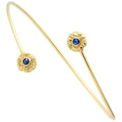 """Seaquin"" Bypass Bangle Bracelet with Blue Sapphires in 18 Karat Gold"