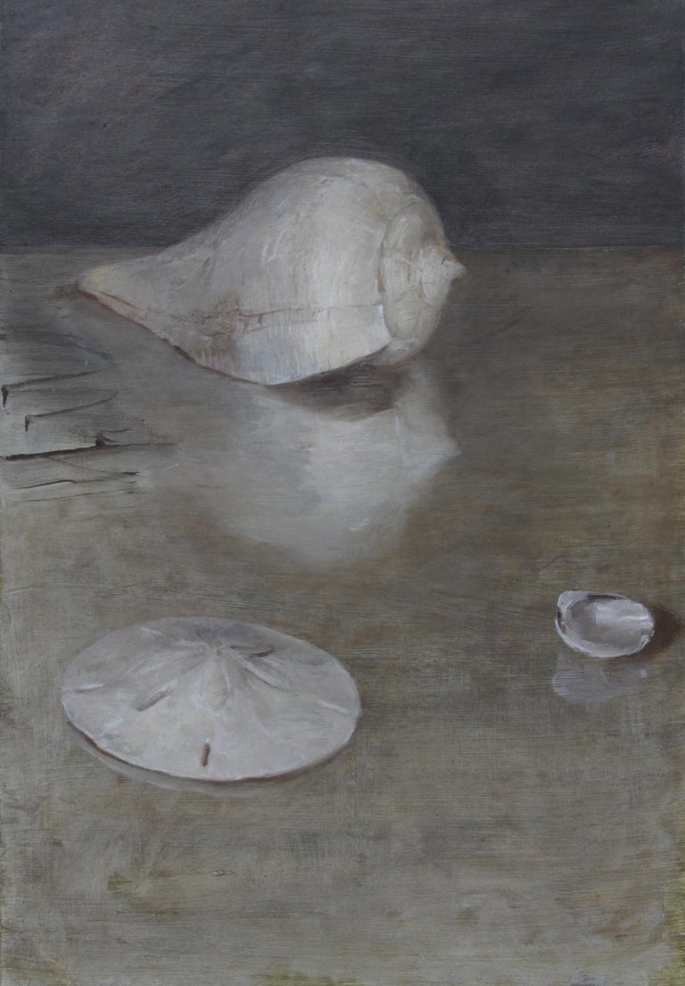The classically composed still life of three shells by Helen Oh brings the viewer in with its richness of color and dreamy quality of the surface. The inherent beauty of the shells are emphasized by the soft surfaces begging the viewer to reach out