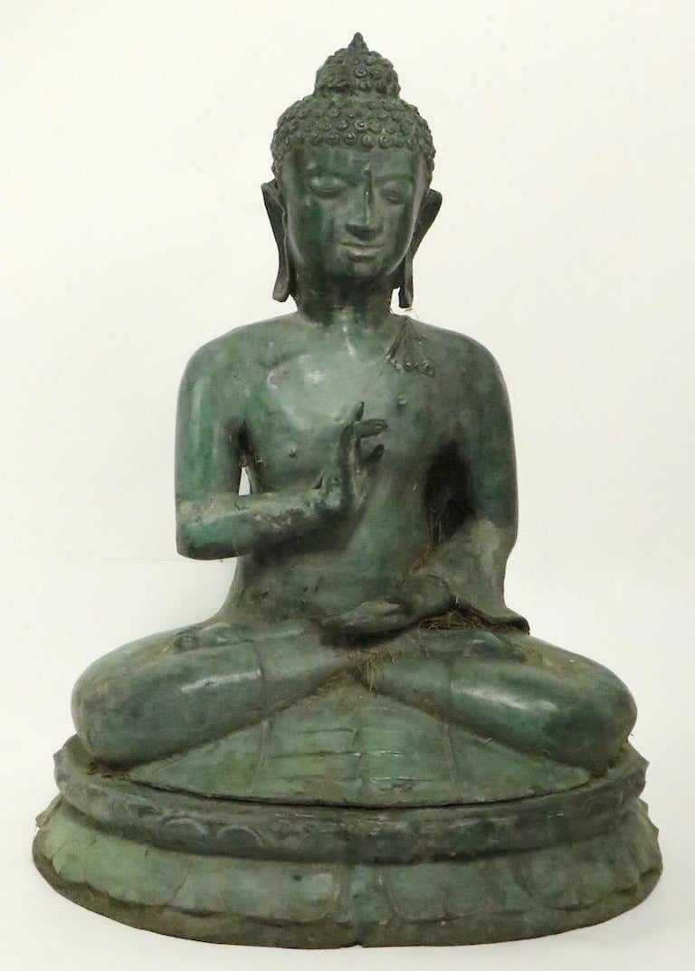Seated verdigris bronze Tibetan Buddha figure, decorative garden statuary in excellent original condition. We believe this item is circa 1970s-1980s however, it is hard to date with specificity. Please view the entire collection of garden statuary