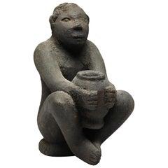 Seated Philippine Miniature Bulul Figure on Stool with Encrusted Holding Jar