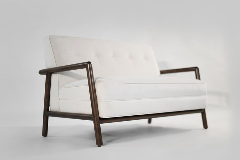 Model 1679 sofa and model 1721 tub chair designed by T.H. Rosbjohn Gibbings for Widdicomb, circa 1950s. Walnut frames fully restored to their original medium brown finish, newly upholstered in Grear Plains off-white velvet by Holly Hunt.  Chair