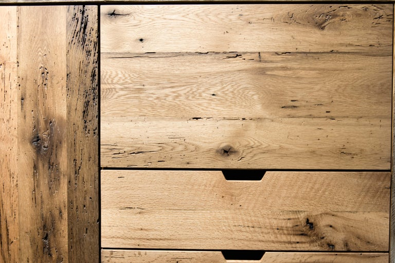Handcrafted in reclaimed white oak and pine. All wood was repurposed from a barn in Hampden MA that was built in 1780. The doors and drawers are constructed with solid oak that came from the floor boards. The wardrobe doors feature a subtle curve