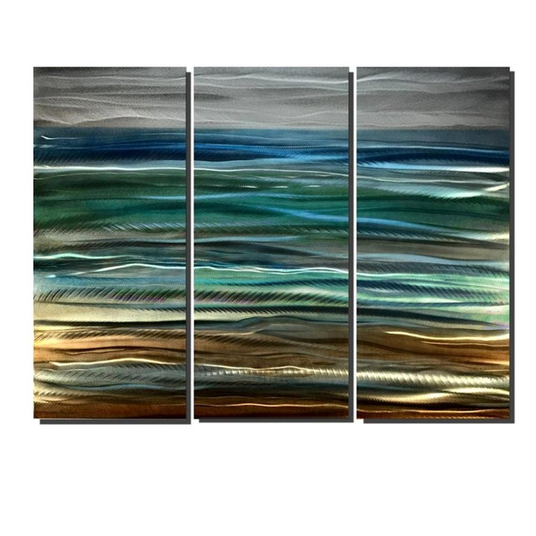 Sea Breeze is a gorgeous coastal painting which consists of 3 aluminum panels with linear, wavy, and even cloudy grind patterns behind airbrushed acrylic paints and a high-gloss clear coat. Perhaps the most impressive element of this design is that