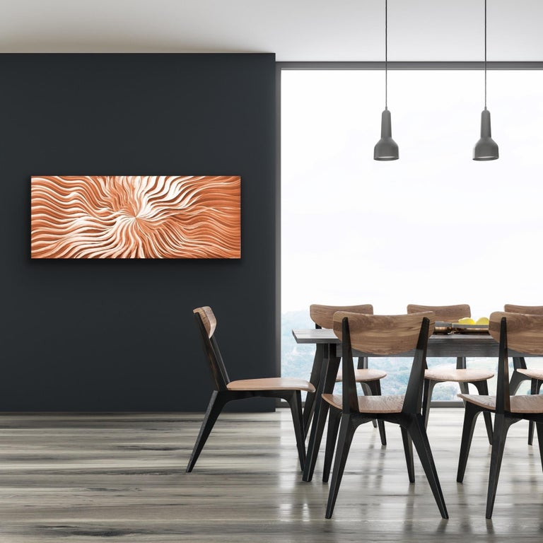 Copper Flexure is a captivating metal wall sculpture crafted in pure, natural copper.  'Flexure' possesses a sort of hypnotic pull – the longer you gaze at the metal wall art, the more drawn you become to the beauty of the flowing lines, following