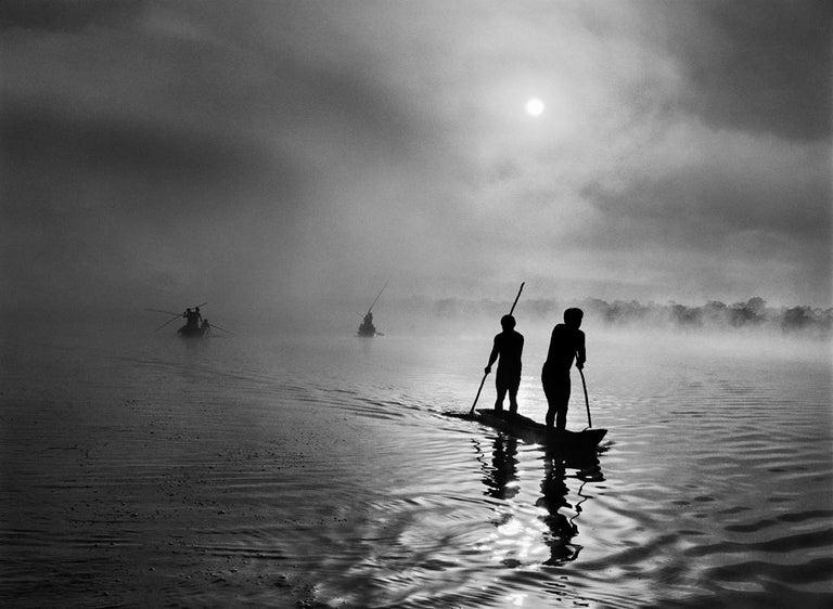 <i>Waura people fishing in the Piulaga Lake. Upper Xingu, Mato Grosso, Brazil</i>, 2005, by Sebastião Salgado