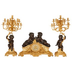 Second Empire Period Patinated and Gilt Bronze Three-Piece Clock Set