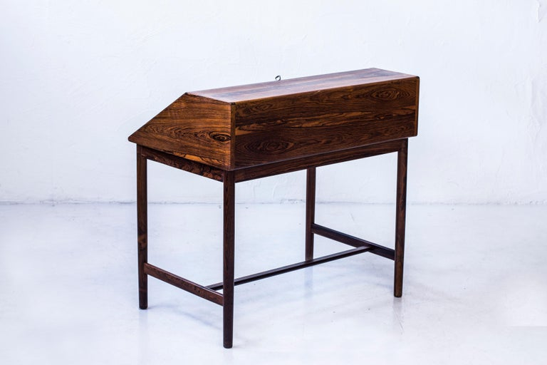 Rare secretaire designed by Torbjørn Afdal. Produced by Nesjestranda møbelfabrikk during the 1960s. Made from palisander with solid wood in the legs and the drawers. The drawers made with very fine detailed zipper joinery. With original key and