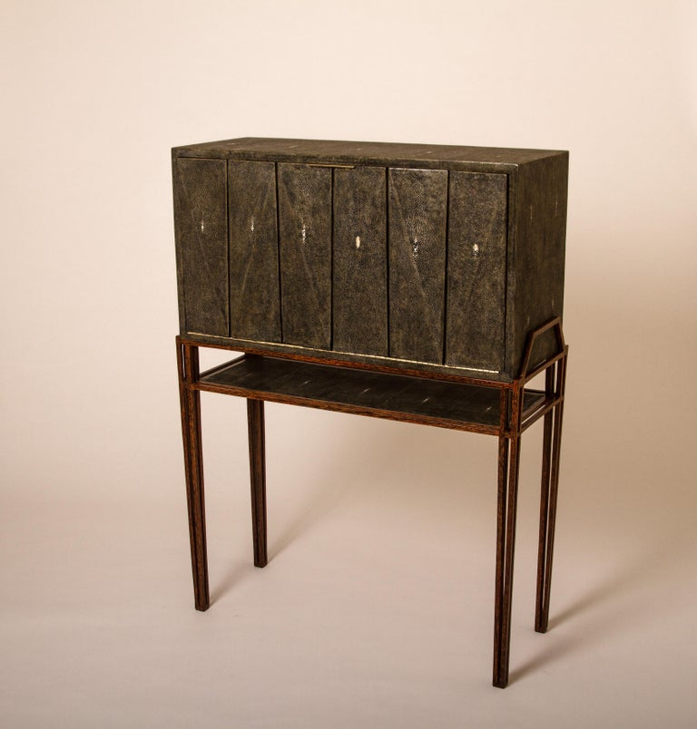 The secrétaire desk is the perfect functional working unit. The flap top opens up into a desk with several compartments, inlaid in black shagreen and wood veneer, to store items and once closed offers a beautiful piece to look at. The geometric