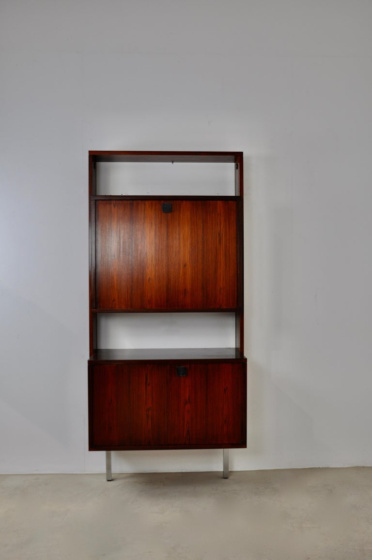 Wooden secretary, metal base, one flap and 2 doors. Wear and tear due to time and the age of the furniture. Measure: Depth of open flap 81cm.