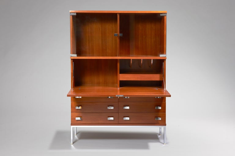 Glass on the upper part  Desk with storage on the median part  Bottom part with drawers.