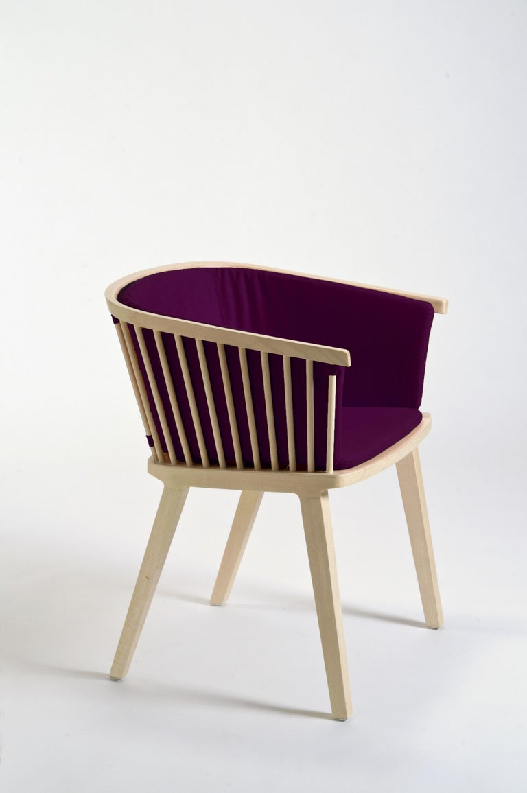 """Secreto is a little armchair to use with dining table or in a living room, modern and traditional at the same time. Inspired to the traditional Windsor chair with a clear brief brilliantly interpreted by duo Lorenz*Kaz: """"to work inspired by"""