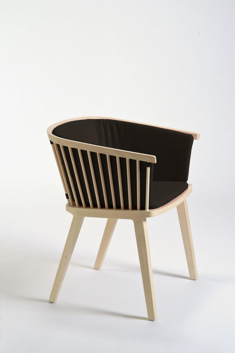 """Secreto is a little armchair to use with dining table or in a living room, modern and traditional at the same time. Inspired to the traditional Windsor chair with a clear brief brilliantly interpreted by duo Lorenz Kaz: """"to work inspired by"""