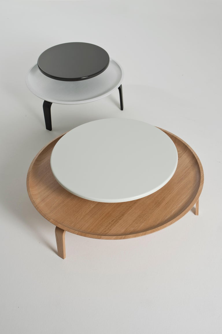 Carved Secreto Round Coffee Table by Colé, Natural Oak and Black Lacquered Top For Sale