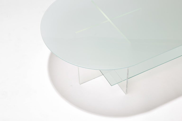 Made to order. Please allow 6 weeks for production.  The Section coffee table is designed with clear vertical structures that give the appearance of floating horizontal spans. The effect is subtle with all clear glass or can be accentuated with