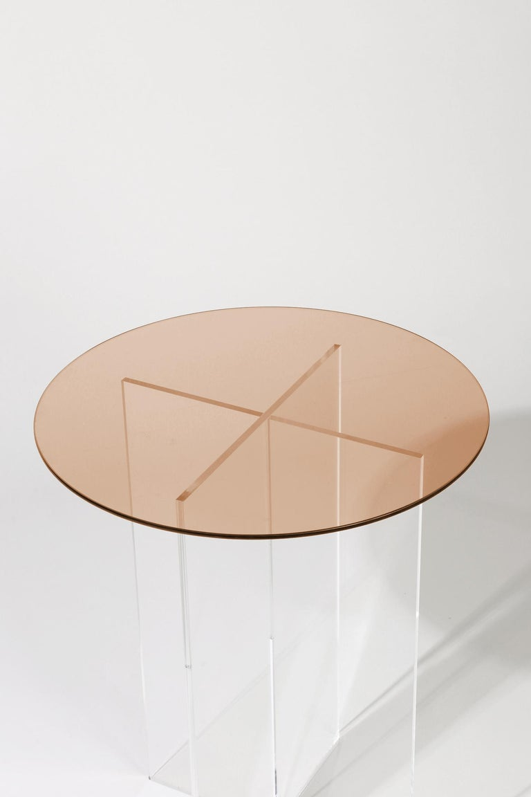 Made to order. Please allow 6 weeks for production.  The Section side table is designed with clear vertical structures that give the appearance of floating horizontal spans. The effect is subtle with all clear glass or can be accentuated with