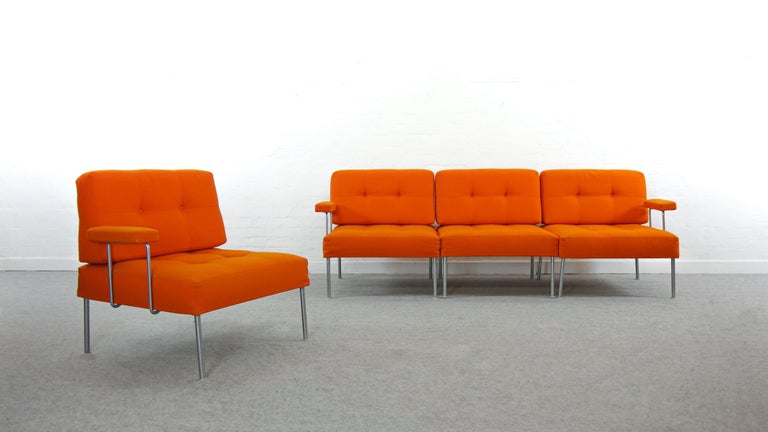 Modular sofa designed by Poul Cadovius for France & Son, Denmark. The sofa consists of 4 seat-elements that can be arranged individually as a sofa or single easy chairs. Comes with 3 interchangeable armrests. Upholstered in its original orange
