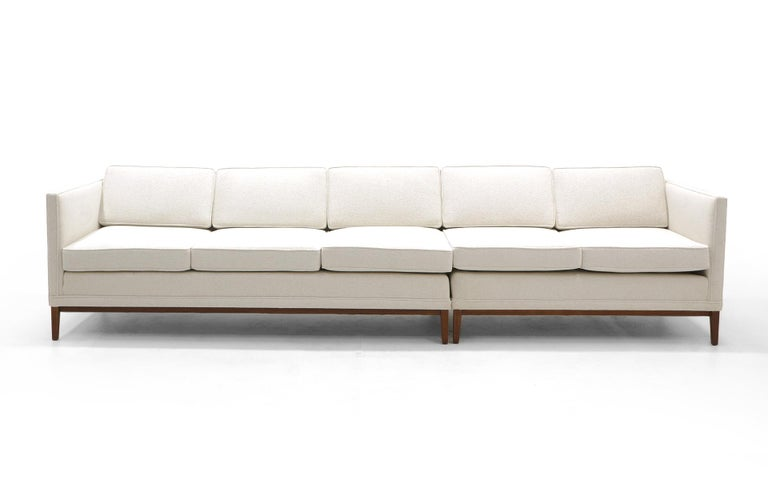 Sectional sofa in the style of Edward Wormley for Dunbar. Even arm, elegant design. Expertly restored and reupholstered in an off white HBF Textiles Merci bouclé. As you see in the photos, these can be used as an L shape or together they make a sofa