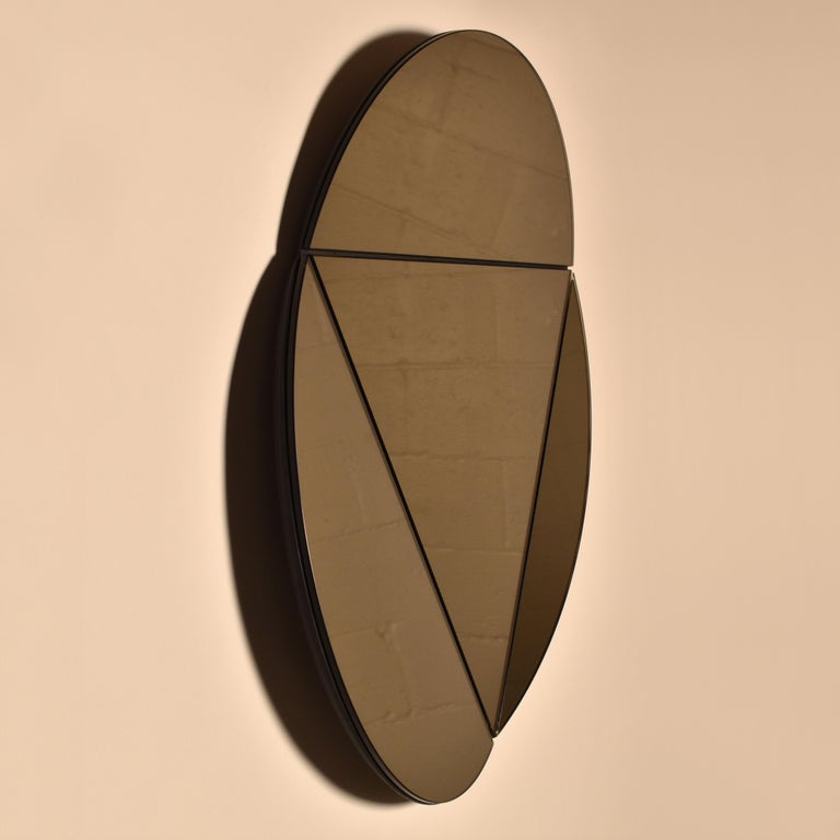 Modular mirror designed and produced by Talbot & Yoon.  The segment mirror was adapted from geometric studies produced during the development of the connection brackets between the arches of our vault light.  The initial 'serious' study project