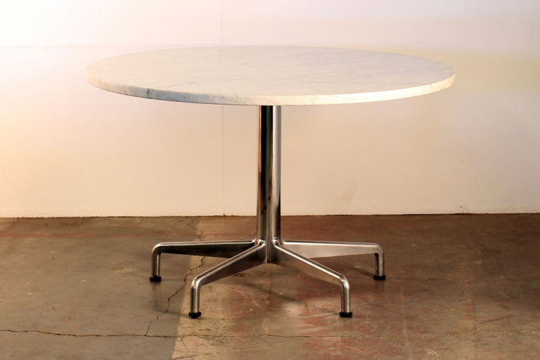 Segmented base and marble-top round dining table by Eames for Knoll.