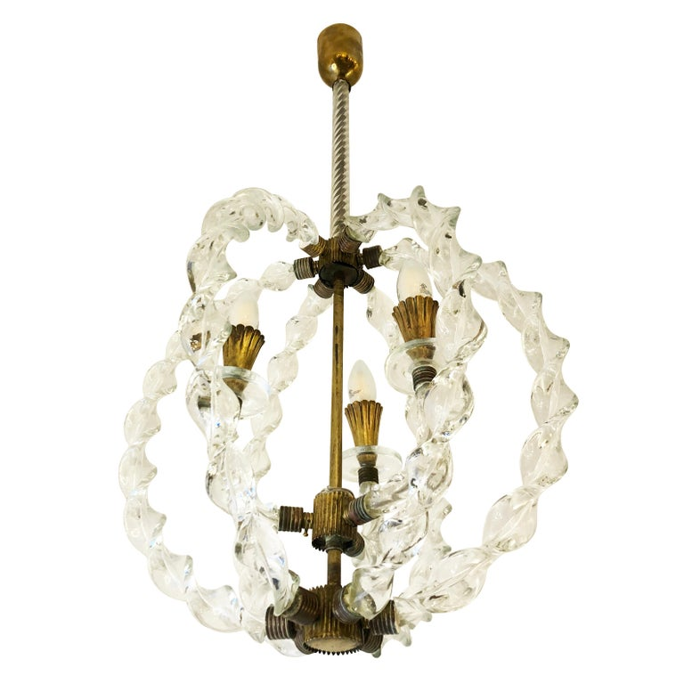 1940s pendant attributed to Seguso. Six Murano glass braids encircle three arms ending with the light sources. Brass fittings. Holds three E12 sockets.