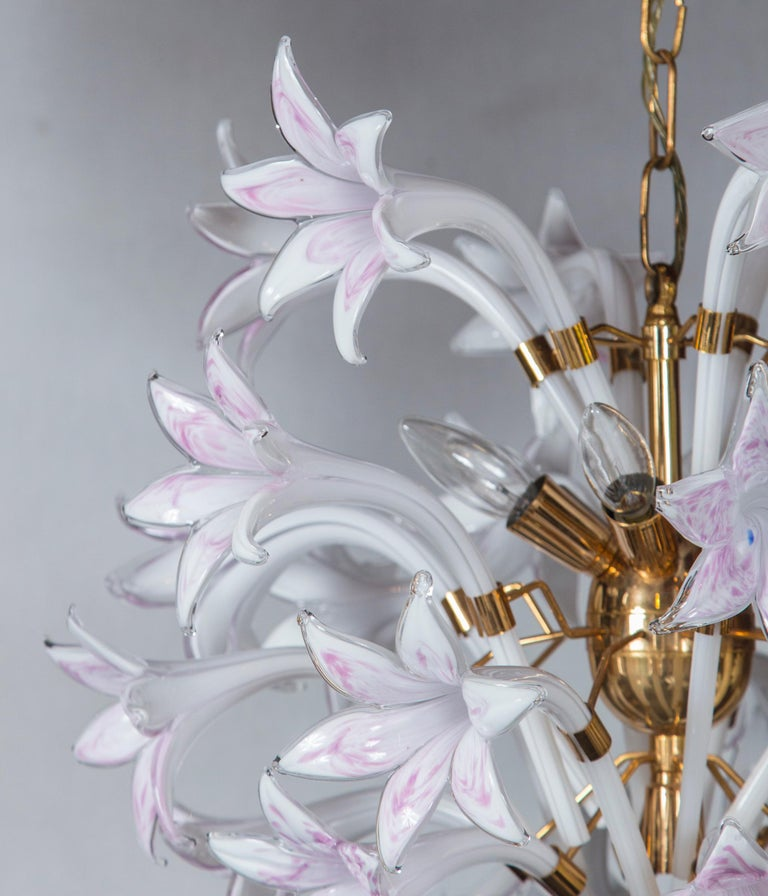 Seguso Murano Venetian glass style lily chandelier with three tiers and brass frame.