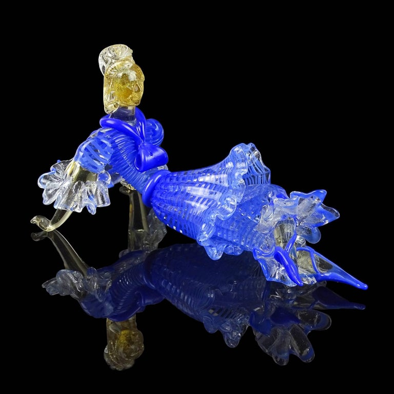 Beautiful, very rare vintage Murano hand blown blue stripped over clear glass Italian art glass resting ballerina dancer sculpture. Documented to the Seguso Vetri D' Arte company, with label still attached. Has an early French style dress with gold