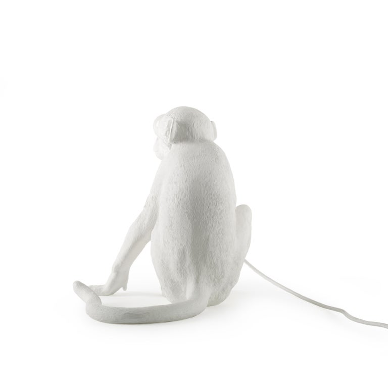 A mischievous monkey stole your light and now it's up to you to get it back. This white resin lamp designed by Marcantonio makes you feel just like in a safari, lost in the deep black Africa.  - Sitting lamp  - Material: Resin - Size: Cm.34 × 30
