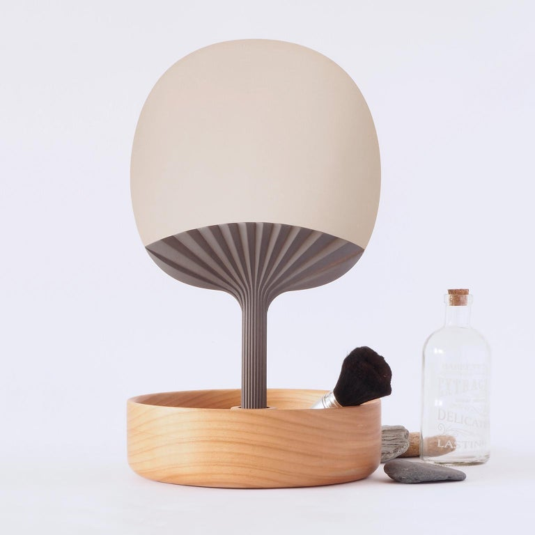 Hand fan mirror with table base Designed by Studio Lido Made in Italy  Our decorative mirror is inspired by the fan proposes the mirror as a feminine accessory symbol of luxury and beauty.   The lightness and harmony of the wrinkles of paper