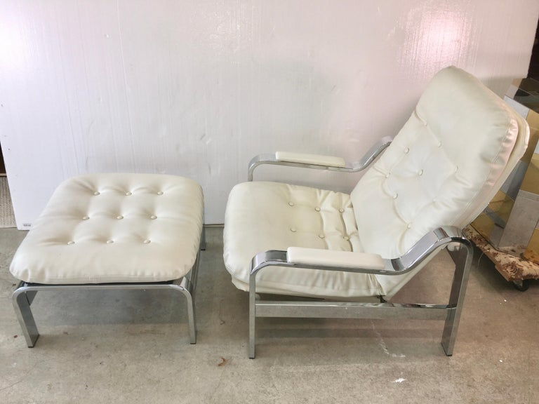 Stylish chrome frame reclining armchair and ottoman imported from Italy by Selig Manufacturing Co. Inc., mid-1970s.