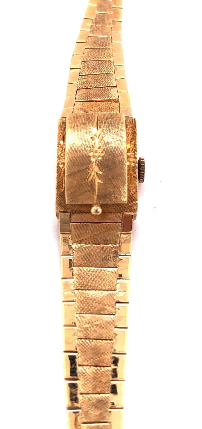 Mid Century Modern Sellita Ladies 14 Karat Yellow Gold Bracelet Wrist Watch 21.9 Grams Swiss 17 Jewels. 6.5 inch. This bracelet wrist watch has a hidden face under an etched cover. Art Deco in Style 21.9 grams.   Sellita is a Swiss movement