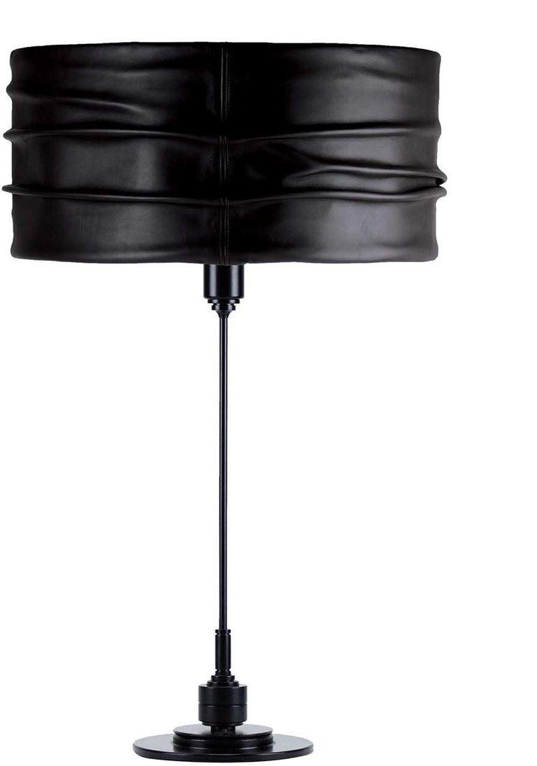 Modern, sleek and versatile, this is the perfect piece for any interior in need of a bold yet sophisticated statement. Displayed in multiples to add drama to a long sideboard in a minimalist living or dining room, this table lamp features a slender