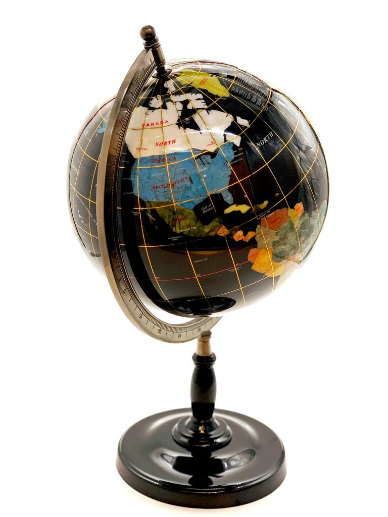 This beautiful globe has been handmade from high quality gemstones, semiprecious stones and shells. Incredible detail, individual gemstone or shell for each country and then the globe has been coated with resin for protection. The globe can rotate