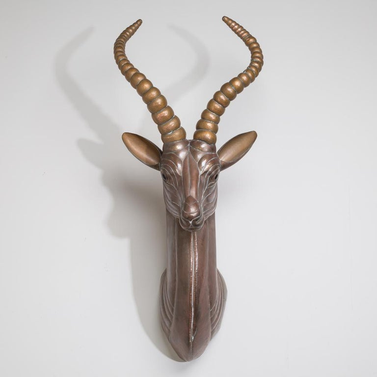 A sensational copper wall mounted Antelope by Sergio Bustamante, Mexico, 1970s  Sergio Bustamante is a Mexican Artist and sculptor. The first exhibit of his works was at the Galeria Misracha in Mexico City in 1966. While Bustamante's works
