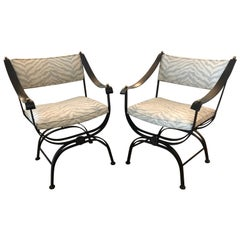 Sensational Pair of Campaign Style Wrought Iron Club Chairs with Leather Arms