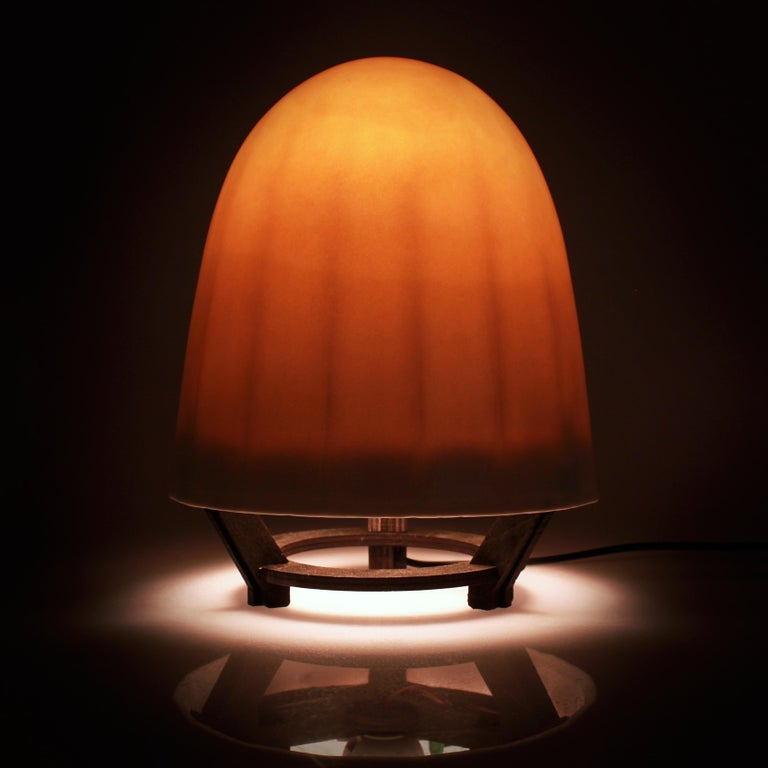 This unique translucent porcelain lamp uses capacitive-sense technology to sense your electromagnetic field and turn on and off when you hover your hand near the lower part of the shade. 