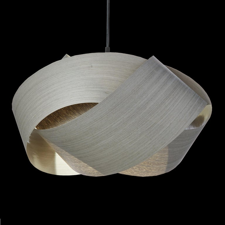 A Scandinavian Modern style pendant. Designers also use this as a Mid-Century Modern statement for alcove, entryway, dining room or conference room. This organic modern shade is customizable, offered in several wood types. Giving a warm light,