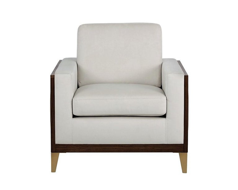 Inspired by early 20th century pleated skirts, this serene club chair is the maximum exponent of sophistication.   Featuring an exposed wood frame with pleated cream engineered leather for durability, and a comfortable seat in piccolo linen