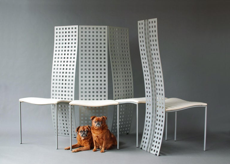 Rare 1980s Postmodern high back set in exceptional all original condition. Elegantly curved aluminum backs with square perforations and distinctive exposed structural spine. Slender tubular steel legs and seat frame. Original white vegan ostrich