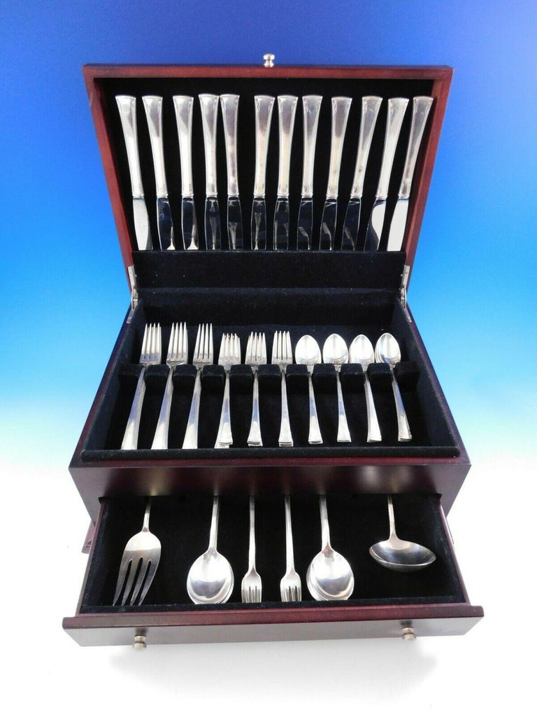 Dinner size serenity by International sterling silver flatware set, 74 pieces. This set includes:  12 dinner size knives, 9 1/2