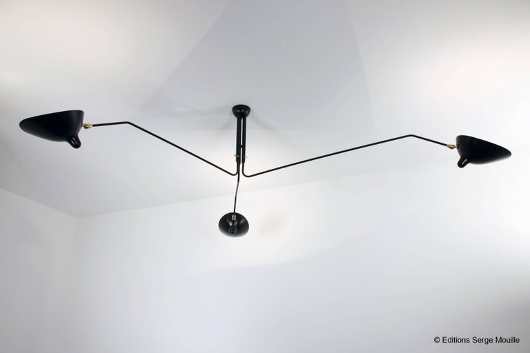 Serge Mouille ceiling lamp with three rotating arms by Les Editions Serge Mouille. Available in black or white.