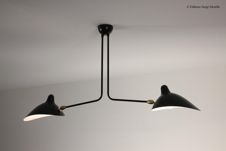 Licensed edition from Serge Mouille's original design After the resounding success of the ceiling light with three arms Mouille produced a very small batch of this ceiling lamp with two still arms. Today we have recently produced again this