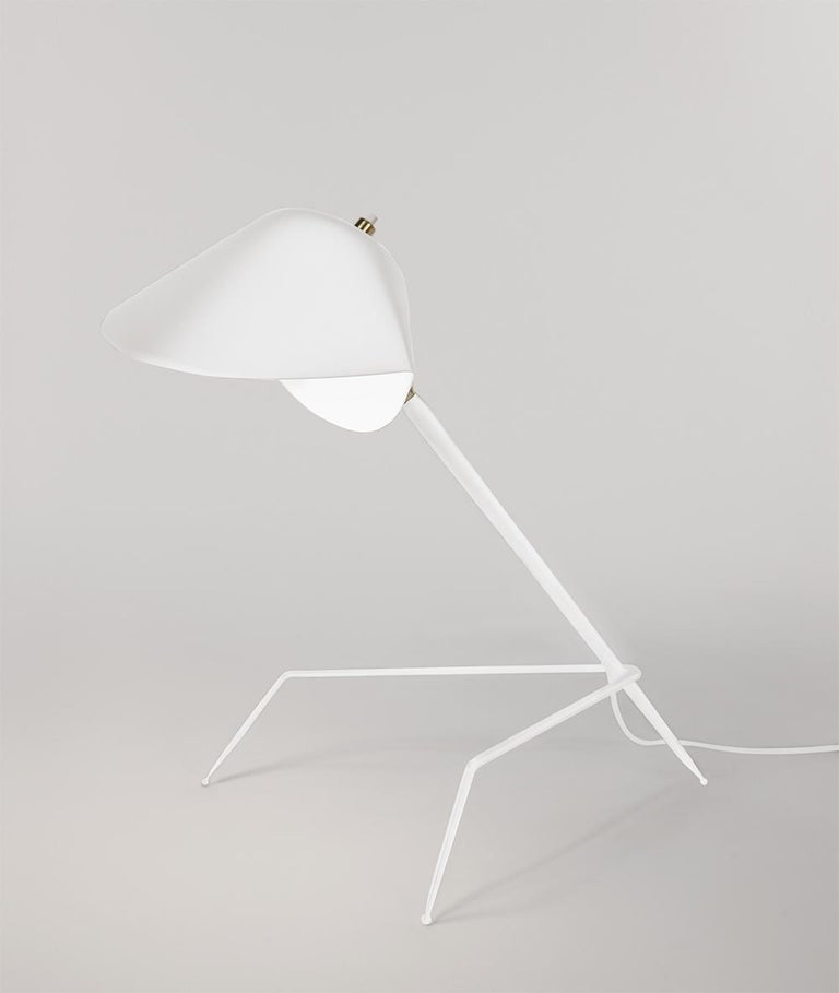 Table lamp model 'Tripod Lamp' designed by Serge Mouille in 1954.  Manufactured by Editions Serge Mouille in France. The production of lamps, wall lights and floor lamps are manufactured using craftsman's techniques with the same materials and